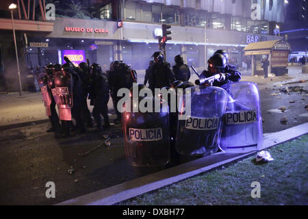 Madrid, Spain. 22nd Mar, 2014. Police in riot gear take positions at 'paseo de la castellana' as they fire rubber - Stock Photo