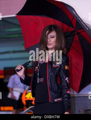 NGM Mobile Forward Racing MotoGP Team Grid Girl holds the umbrella Stock Photo, Royalty Free ...