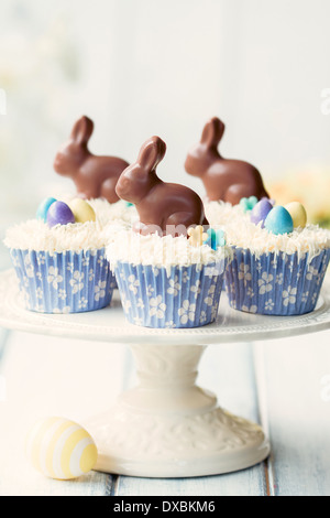 Cupcakes decorated with chocolate Easter bunnies - Stock Photo
