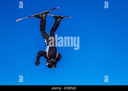 Out of control skier upside down - Stock Photo