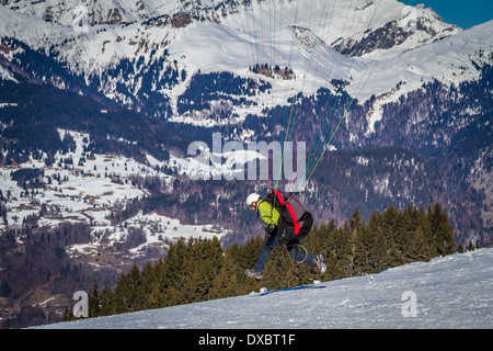 paraglider taking off in the French Alps - Stock Photo