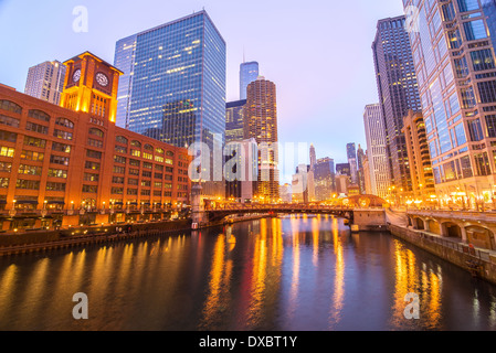 View of skyscrapers in downtown Chicago on either side of the Chicago River - Stock Photo