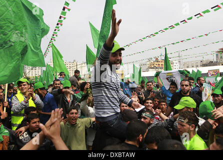Gaza, Palestinian Territories. 23rd Mar, 2014. Palestinian supporters of the Hamas movement during a rally to mark - Stock Photo