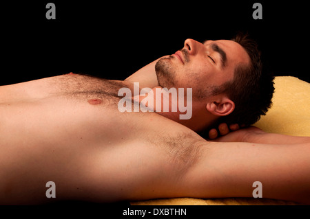 Young man relaxing - Stock Photo