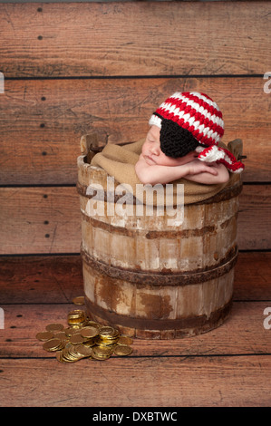 Sleeping baby boy wearing a pirate hat and eye patch - Stock Photo