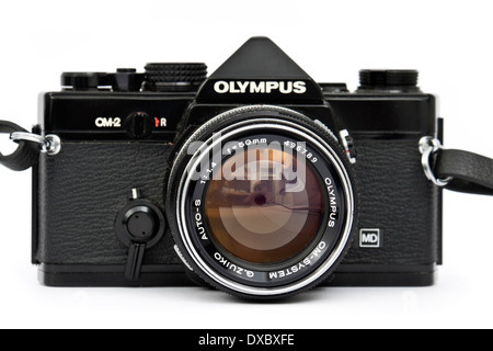Vintage late 1970's Olympus OM-2 professional 35mm SLR film camera with Olympus G.Zuiko 50mm f/1.4 prime lens - Stock Photo