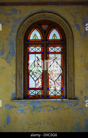 Broken stained glass window - Stock Photo