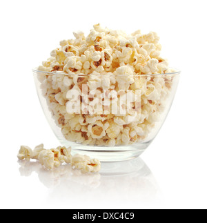 Popcorn in glass bowl isolated on white background - Stock Photo