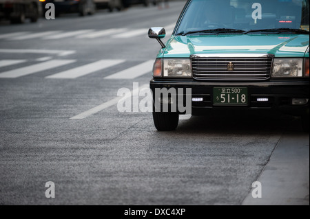Taxi in Ginza district, Tokyo, Japan - Stock Photo