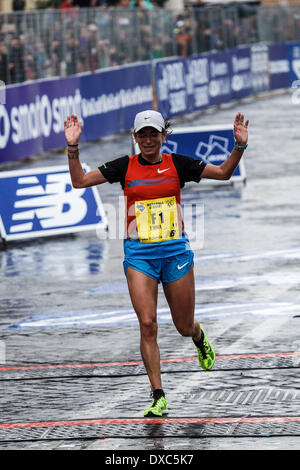 Rome, Italy – March 23, 2014: Italian runner Emma Quaglia, 3rd, crosses the finish line of the 20th edition of the - Stock Photo