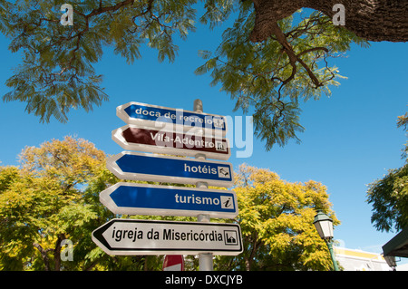 Tourist directions on a street sign, Faro Portugal - Stock Photo