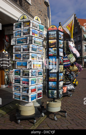 tourist postcards for sale on stand at volendam netherlands - Stock Photo