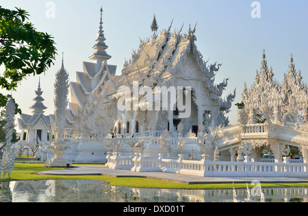"Wat Rong Khun,better known as ""the White Temple"" is  in the style of a Buddhist temple is one of the most recognizable - Stock Photo"