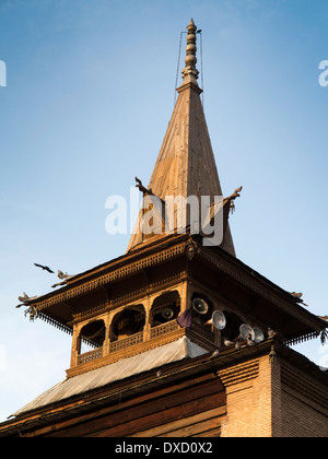 India, Kashmir, Srinagar town, wooden tower and spire of historic Jamia Masjid mosque, built 1394 - Stock Photo