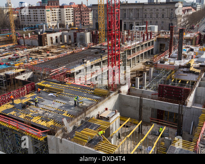 View over a building site - Large-scale inner city centre urban  construction site, constructing new office blocks - Stock Photo
