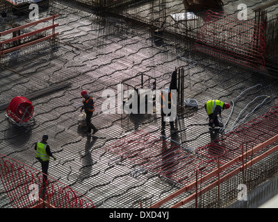 Construction workers on a city centre construction site - Stock Photo