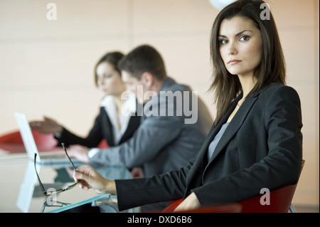 Business people at conference table - Stock Photo