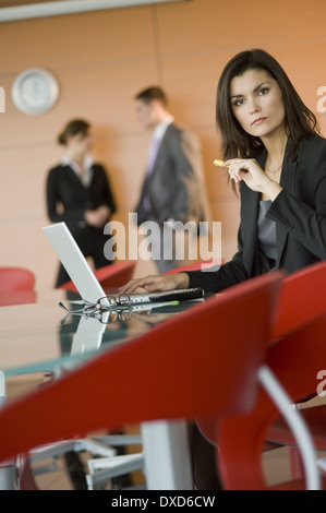 Businesswoman at meeting with laptop - Stock Photo