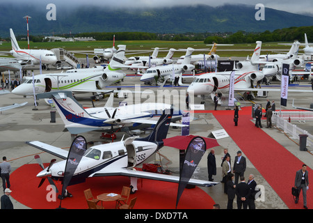 Aircraft on the static park at the 2013 Ebace Expo in Geneva, Switzerland. - Stock Photo