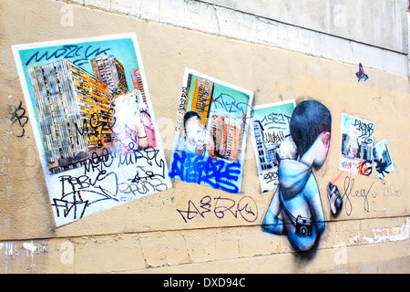 Wall with overlapped graffiti paintings in Paris, France - Stock Photo