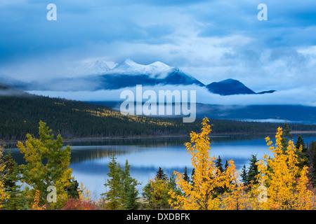 autumn colours at Nares Lake, with Montana Mountain beyond, near Carcross, Yukon Territories, Canada - Stock Photo