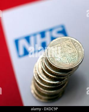 National Health Service logo and money, London - Stock Photo