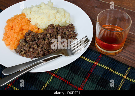 Traditional Scottish haggis, neeps and tatties with whisky also known as a burns supper. - Stock Photo