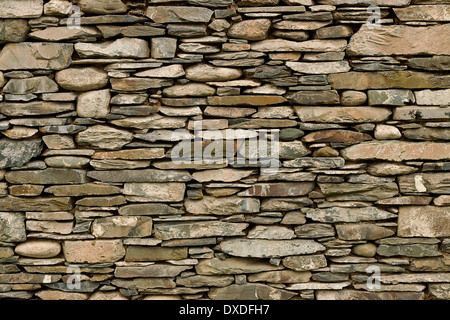 Natural stone wall hand crafted by an experienced mason, great background or wallpaper for builders. - Stock Photo