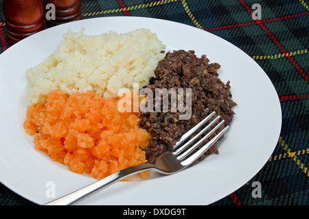 Traditional Scottish haggis, neeps and tatties also known as a burns supper. - Stock Photo