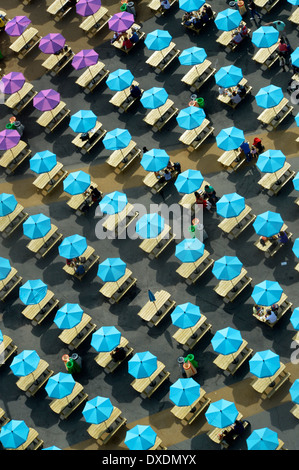 Colourful parasols shading picnic tables in the London Olympic Park - Stock Photo