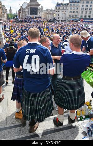 Scotland football fans gathering in Trafalgar Square prior to an international match at Wembley - Stock Photo
