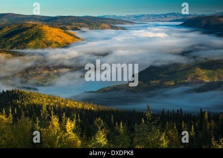 Mist in the valley of the Yukon River at dawn, downstream of Dawson City from Dome Hill, Yukon Territories, Canada - Stock Photo