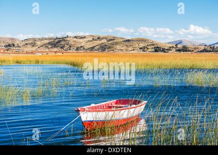 boat in Titicaca Lake in the peruvian Andes at Puno Peru - Stock Photo