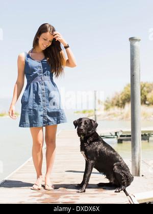 Woman with dog standing on jetty, Salt Lake City, Utah, USA - Stock Photo