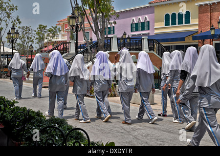 Group of Thai Muslim schoolgirls wearing school uniform and traditional Hijab headwear. Thailand S. E. Asia - Stock Photo