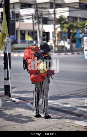 Young female backpacker traveling alone through Thailand S.E. Asia - Stock Photo