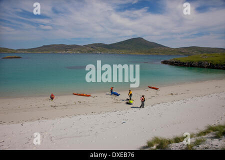 Beautiful sandy beach on the island of Vatersay with castlebay, Isle of Barra in view. - Stock Photo