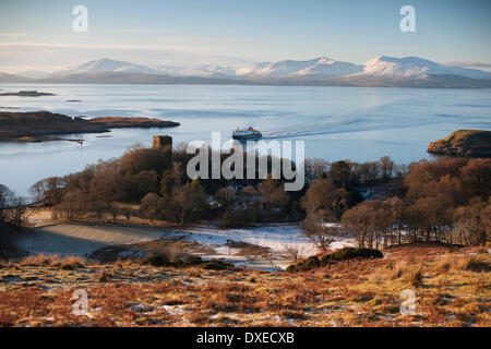 M.V.Clansman  approaches Oban bay with Dunollie Castle and Mull in view. Argyll - Stock Photo