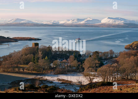 Winter view towards Dunollie Castle and mull with the M.V.Isle of Mull ferry in view, Oban, Argyll - Stock Photo