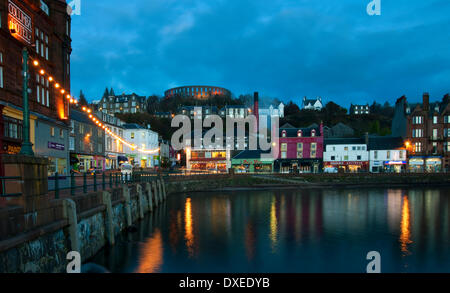 Christmas/new year lights in Oban town centre with floodlit mcCaigs tower.from north pier.Oban,Argyll. - Stock Photo