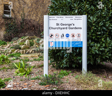 St. George's Graveyard Gardens sign and Alpine garden with broken old tombstones  - St George the Martyr, Southwark, - Stock Photo