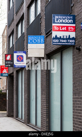 Estate Agents signs - property for sale and to let in Long Lane, London, SE1 - Stock Photo