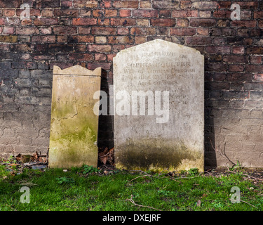 Tombstones of old family graves in St George's Graveyard Gardens, St George the Martyr church, Southwark, London, - Stock Photo