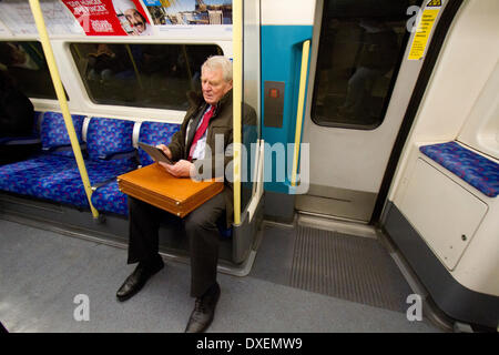 London UK. 25th March 2014. Former leader of the Liberal Democrat Party Paddy Ashdown is seated reading from a computer - Stock Photo