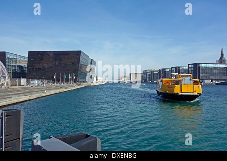 New Movia water bus approaches The Royal Danish Library  (the Black Diamond) stop on the waterfront in Copenhagen - Stock Photo