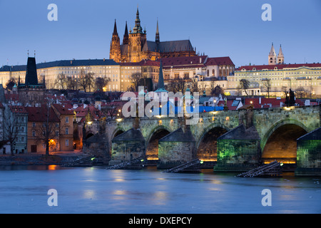 the Castle District, St Vitus Cathedral and the Charles Bridge over the River Vltava at dusk, Prague, Czech Republic - Stock Photo