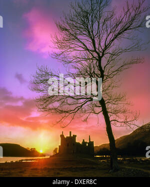 Sunset over the ruins of Kilchurn Castle, Loch Awe, Argyll - Stock Photo