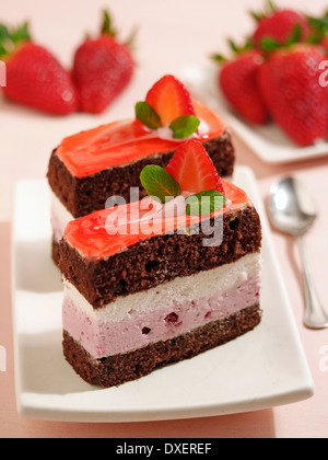 Sponge cake with cream and strawberries. Recipe available. - Stock Photo