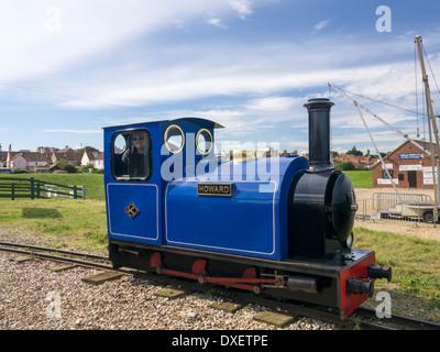 small miniature blue steam  train on narrow gauge railway Wells next the sea Norfolk England - Stock Photo