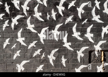 Birds on the Wall,Graffiti from Manchester's Northern Quarter. - Stock Photo